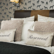Reserved Cushions on Bed in a Pet Friendly Room