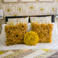 Yellow Floral Cushions on Bed in En Suite Double